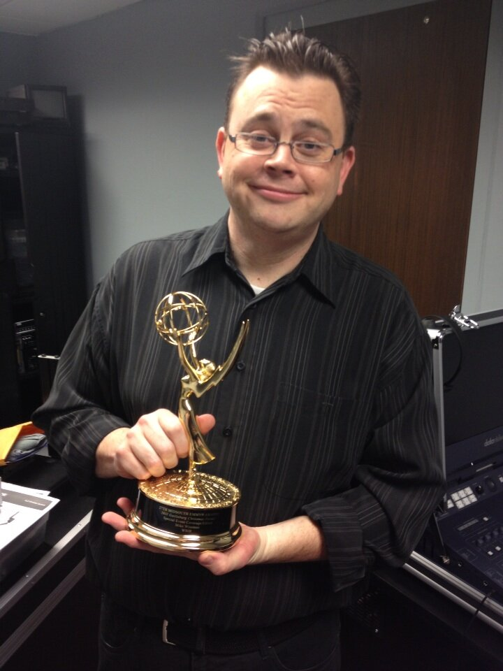 Mike Wiseman with his Emmy