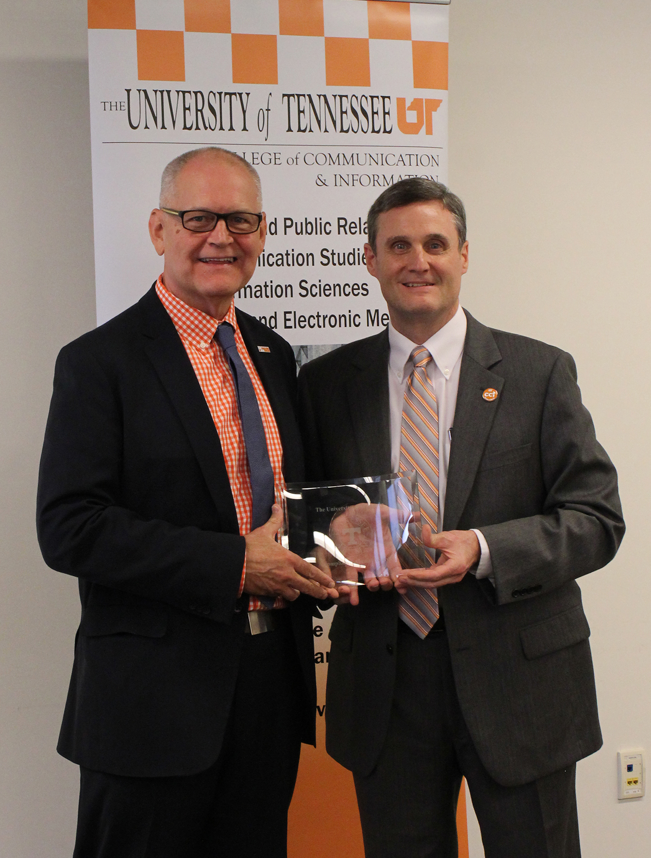 Wendell Potter received award from Dean Wirth