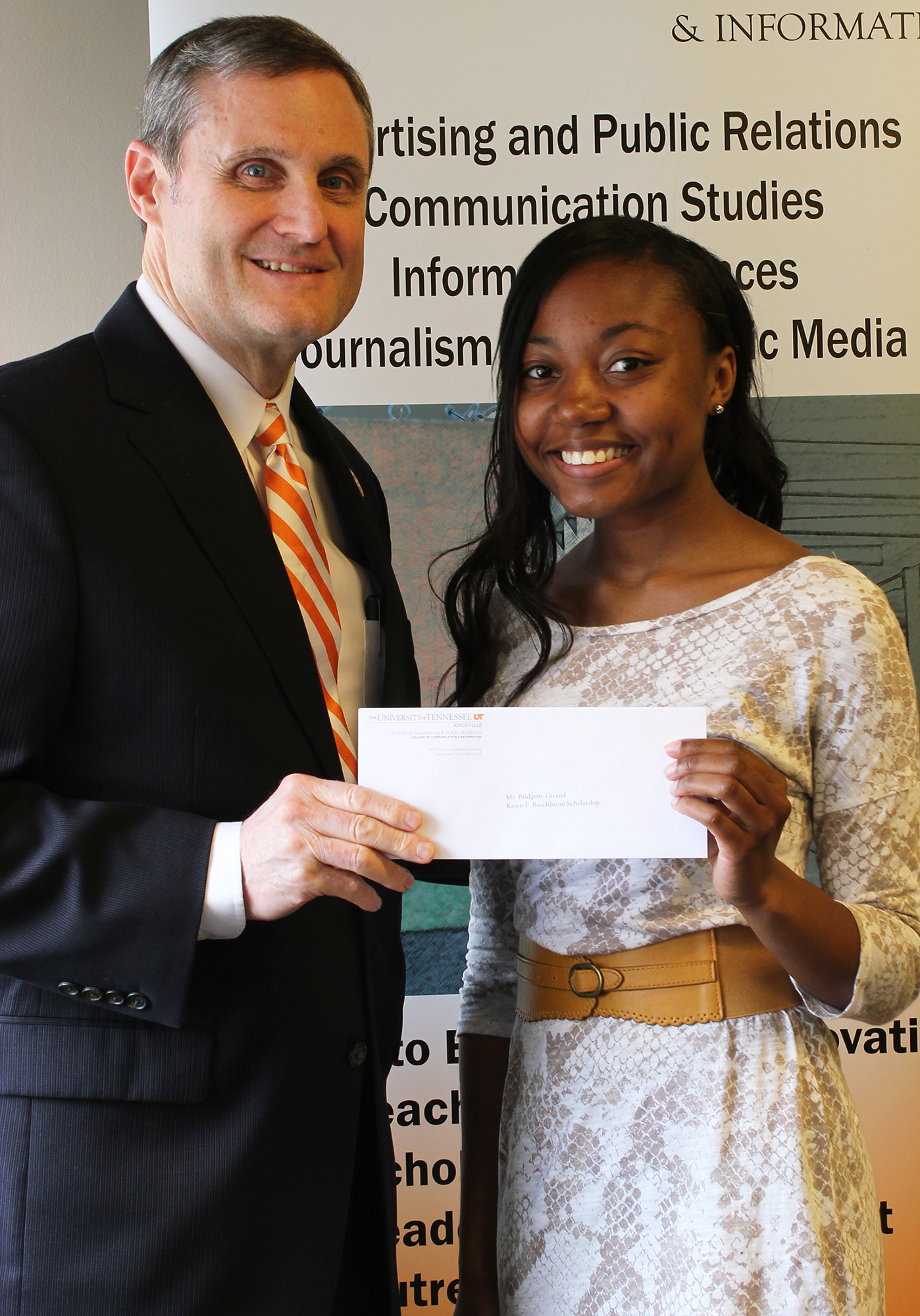 Public Relations student Bridgette Givand with Dean Mike Wirth as she receives the Karen Buchsbaum Scholarship.